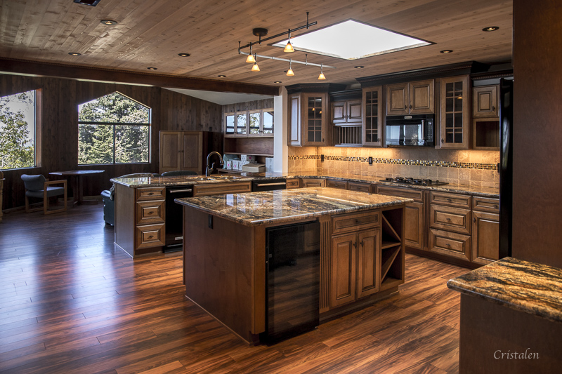 A kitchen with two islands and a counter.