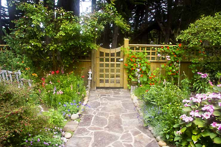 Interior of a fence with walkway and garden.