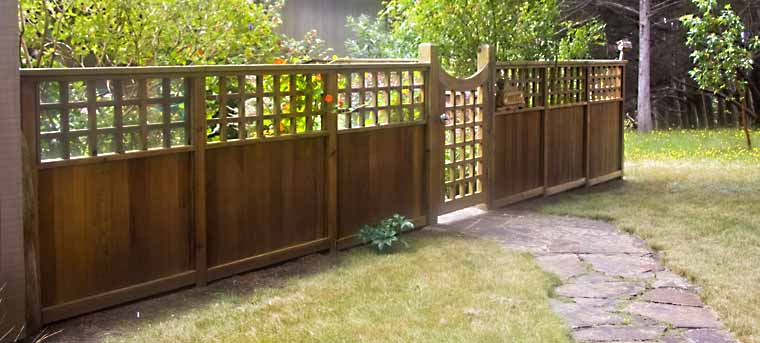 Exterior of a fence with walkway and gate.